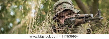 Camouflaged Soldier On Ground
