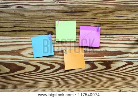 Sticker Notes Isolated On The Wooden Background