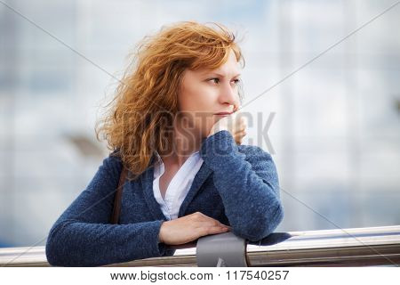 Portrait Of A Young Woman Looking Thoughtfully Into The Distance