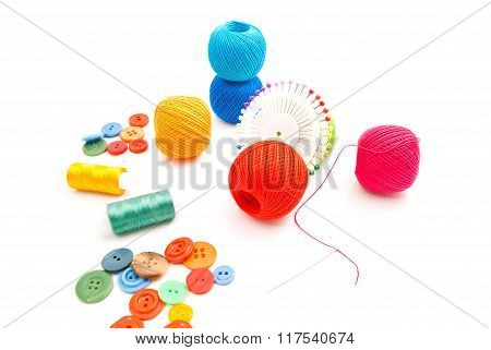 Colored Pins, Thread And Buttons On White