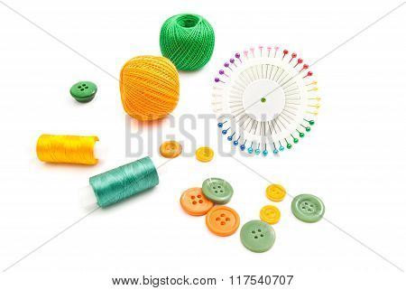 Pins, Threads And Buttons On White