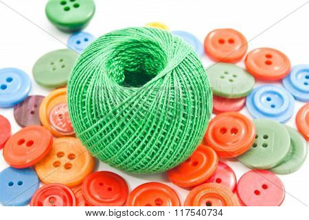 Green Ball Of Thread And Colored Buttons
