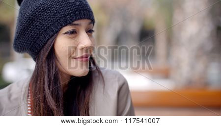 Cute smiling young woman in knitted hat
