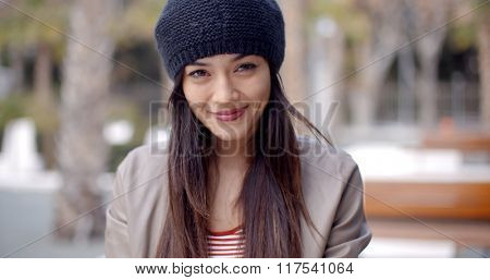 Pretty thoughtful young woman in a woolly cap