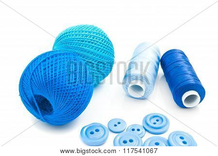 Blue Spools Of Thread And Plastic Buttons