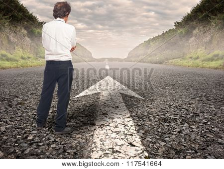 pensive businessman standing on a road