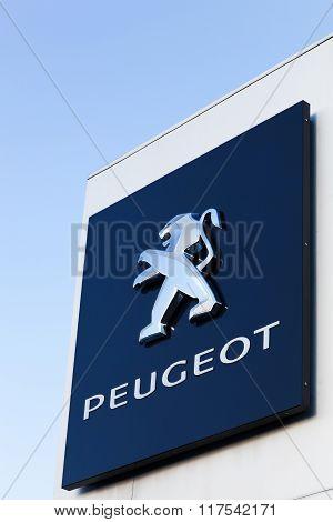 Peugeot logo on a wall