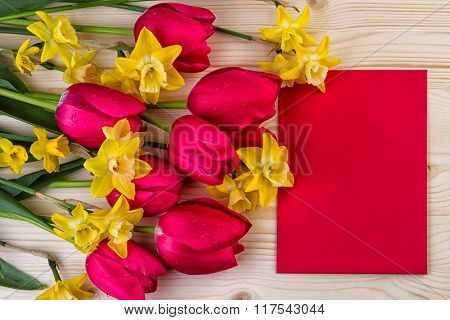 Spring flowers with paper sheet text space