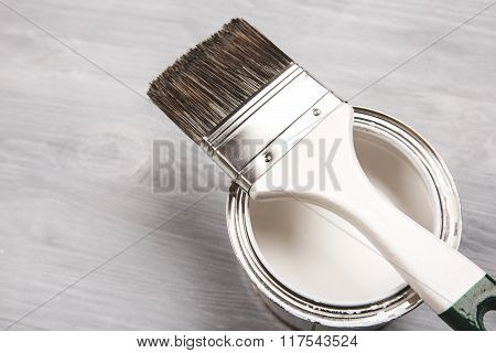 Paint brush on the can. Top view.