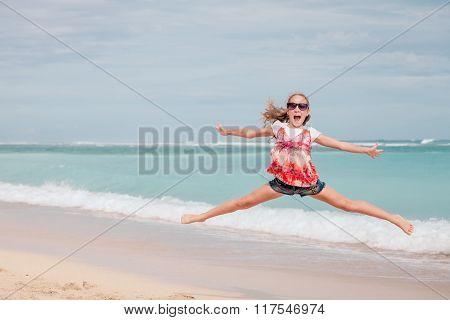 Happy Teen Girl  Jumping On The Beach