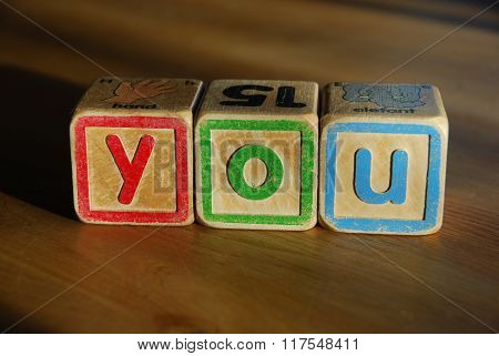 Spelling you with toy blocks
