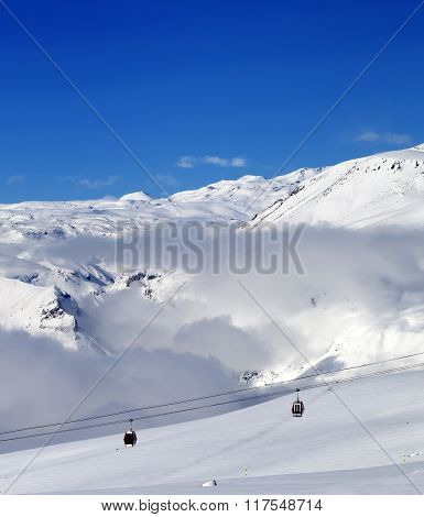 Off-piste Snowy Slope And Cable Car At Sun Day