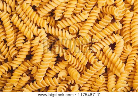 Fusilli pasta forming a textured background