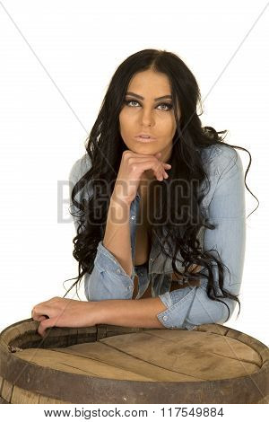 Woman In Denim Shirt Lean On Whisky Barrel Serious
