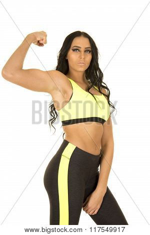 Woman In Green And Black Fitness Clothes Flex One Arm