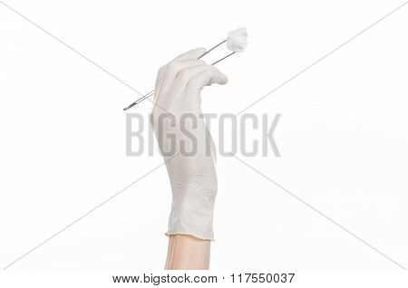 Medicine And Surgery Theme: Doctor's Hand In A White Glove Holding Tweezers With Swab Isolated On Wh