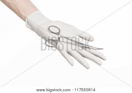 Surgery And Medical Theme: Doctor's Hand In A White Glove Holding A Surgical Clip Isolated On White