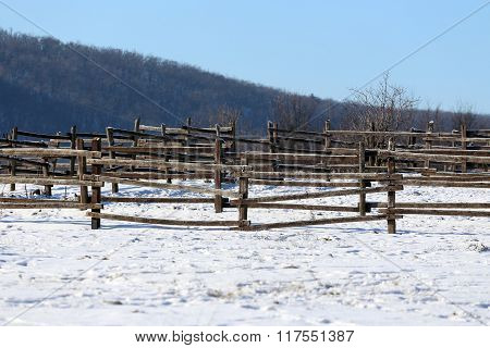 Snowy Horse Ranch Fence And Snow Filled Corral