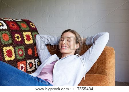 Smiling Older Woman Relaxing At Home