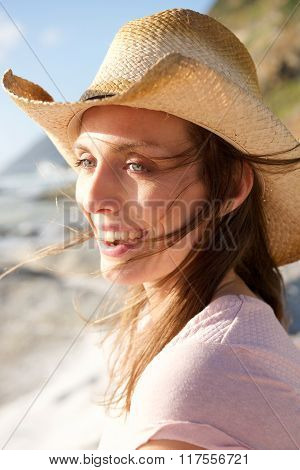 Attractive Woman Smiling With Hat At The Beach