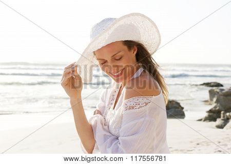 Smiling Older Woman With Hat At The Beach