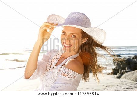 Beautiful Woman Smiling With Hat At The Beach
