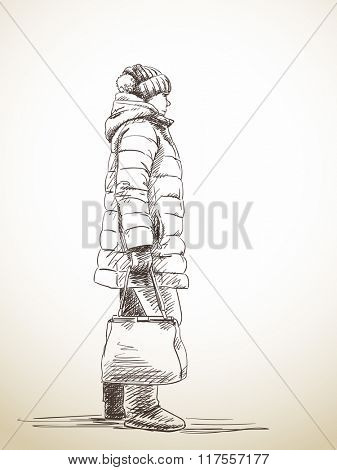 Sketch of standing woman in down jacket, Hand drawn illustration