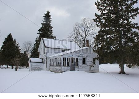 A farm house in winter
