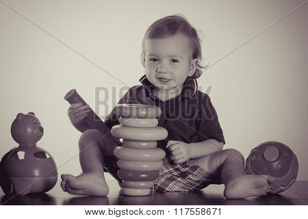 Happy Baby Boy Playing With Toy