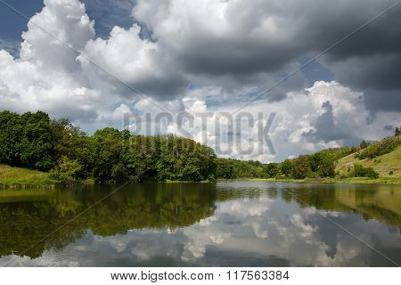 Beautiful Nature Landscape. Trees Reflected On Water At Summertime
