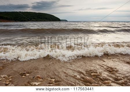 Waves On The Sandy Banks Of The River