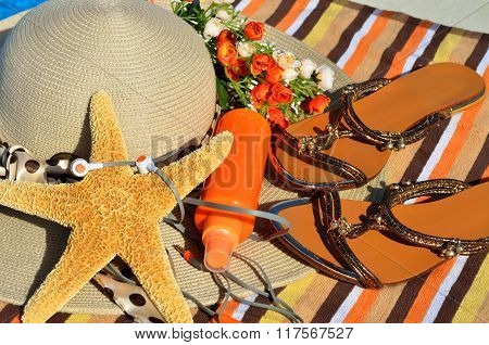 Beach Hat, Flip Flops, Head Phones, Sun Spray.