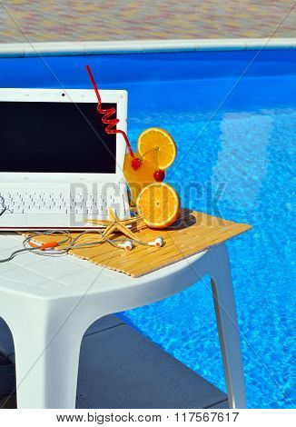 Laptop, Headphones, Cocktail Near The Swimming Pool.