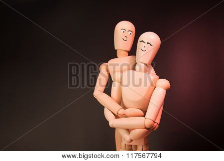 Couple Staged With Puppets Hugging