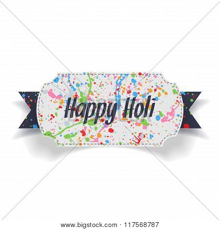 Happy Holi Text and color Splashes on paper Label