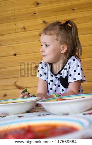 Little Girl Eats Soup In Arbor