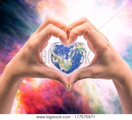 World In Heart Shape With Over Women Human Hands On Blurred Natural Background Blue Cyan Turquoise T