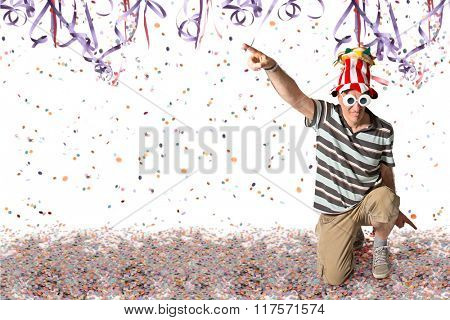Brazilian man pointing, Carnival confetti and serpentine background