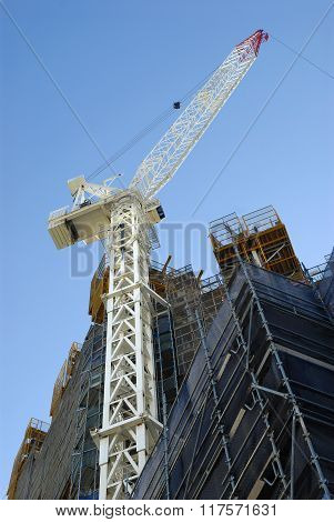 Tall Skyscraper High Rise Building Construction With Crane, Low Angle View