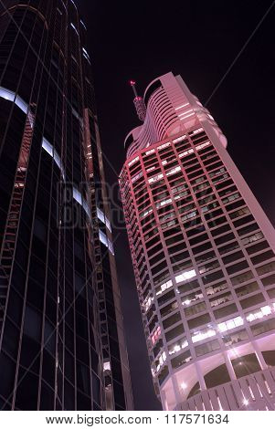 Tall Skyscraper Buildings At Night, Low Angle View