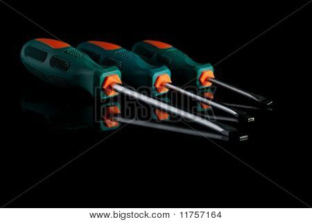 Screwdrivers on black background