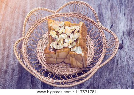 Toast Or Bread Pour Honey With Pumpkin Seeds On Wood Table