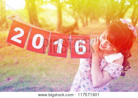 Smile Of Cute Woman Hand Holding Paper Sign 2016, Happy New Year Colorful