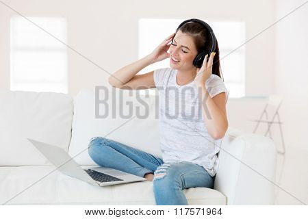 happy young woman with headphones listening to music
