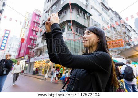 Woman take photo with mobile phone