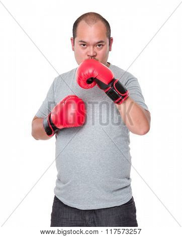 Man wearing red boxing gloves