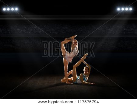 Young girls engaged art gymnastic at sports hall