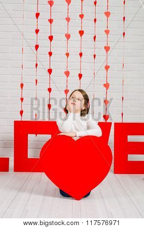 Little girl with a decoration for Valentines Day