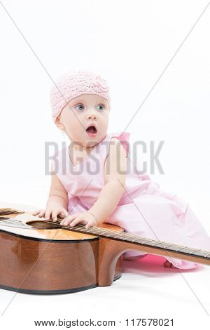 little child baby girl lady pink dress playing pyramid wooden toys isolated on white studio shot