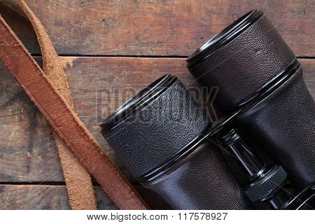 Old Binoculars On Wood